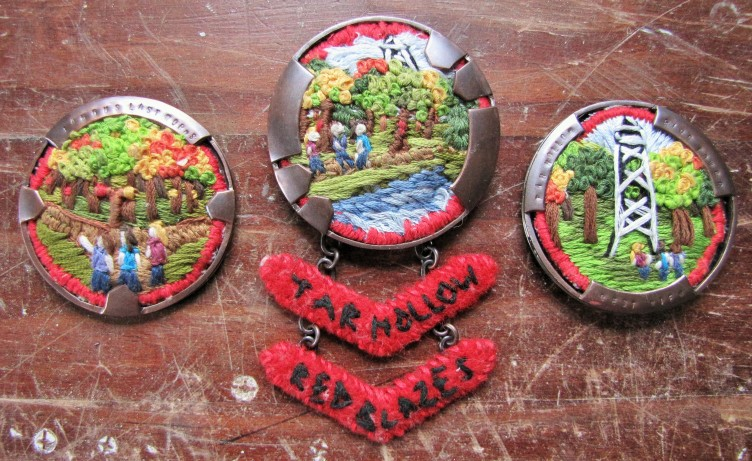 Fronts of all three brooches.  (Left)  Famous Last Words... It's a boy scout trail.  How long can it be.  (Center)  Tar Hollow - Red Blazes.  (Right) Tar Hollow Fire Tower - Best View... of just how lost we are